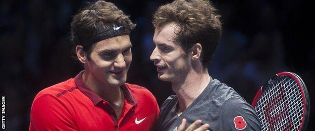 Roger Federer consoles Andy Murray after his defeat at the ATP World Finals