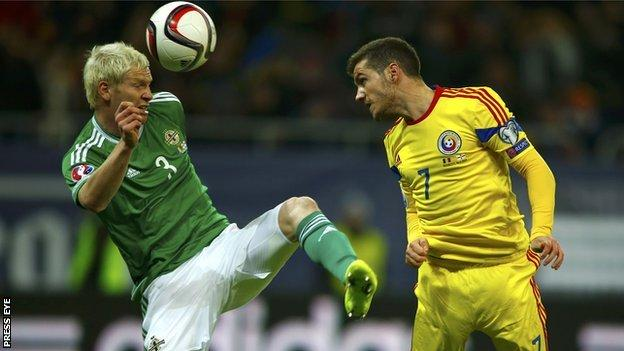 Ryan McGivern and Alexandru Chipciu in action as Northern Ireland go down in Bucharest
