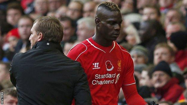 Liverpool striker Mario Balotelli (right) and Reds boss Brendan Rodgers