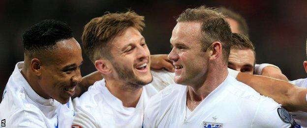 England striker Wayne Rooney celebrates