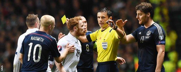 Ireland's Stephen Quinn and Scotland's Chris Martin argue at Celtic Park