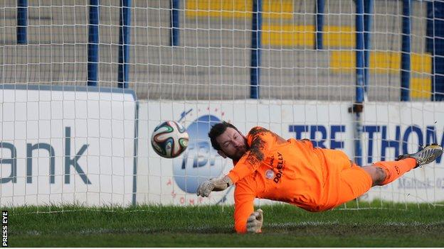Dungannon keeper Andy Coleman saves Neil McCafferty's corner