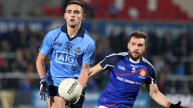 Dublin's Niall Walsh gets to the ball ahead of Ulster team player Ryan McCluskey