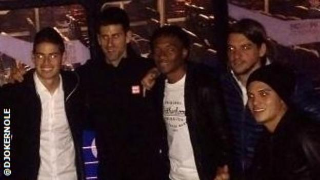 Novak Djokovic and members of the Colombia football team