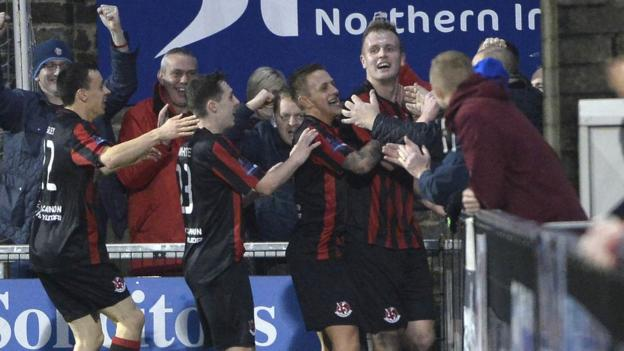 Jordan Owens celebrates with Crues fans after completing his double in the 4-1 win over Cliftonville in the north Belfast derby
