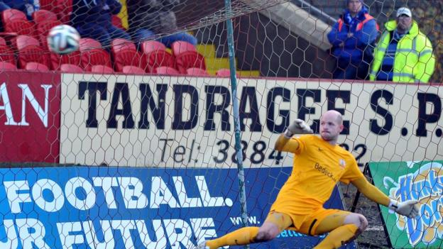 Glenavon keeper Alan Blayney can only watch on as Chris Casement's penalty gives Portadown the lead in the Mid-Ulster derby at Shamrock Park
