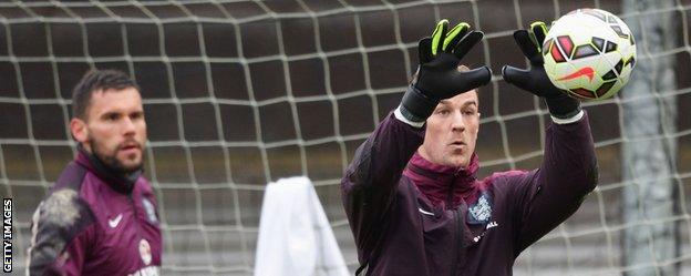 England goalkeepers Ben Foster and Joe Hart in training