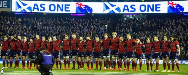 Scotland line-up arm in arm before kick-off