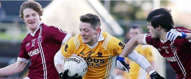 Slaughtneil pair Ronan Bradley and Karl McKaigue challenge Clontibret forward Conor McManus