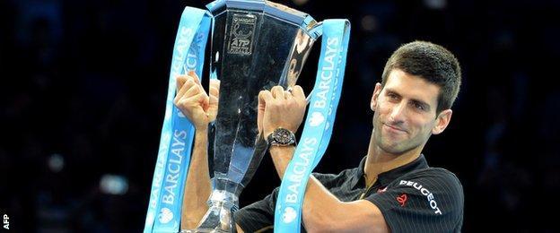 Novak Djokovic collects the ATP World Tour Final trophy