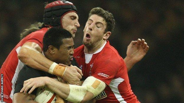 Luke Charteris and Alex Cuthbert tackle New Zealand's Julian Savea in November, 2012