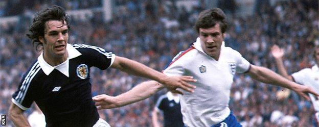 Joe Jordan in action for Scotland