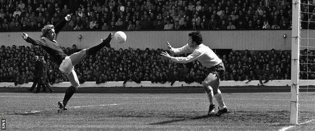 Denis Law tries to lob England goalkeeper Gordon Banks