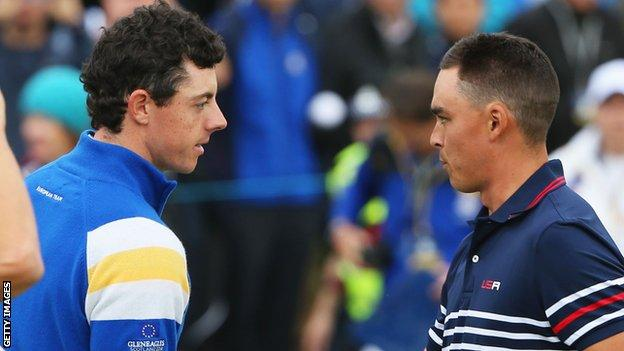 Rory McIlroy and Rickie Fowler shake hands after the Northern Ireland player wins their single match at the Ryder Cup in September