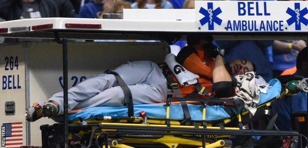Stanton is carried off on a stretcher after being hit in the face