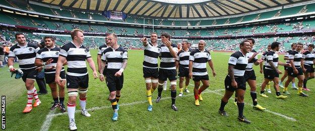 Barbarians celebrate after beating England in June 2014