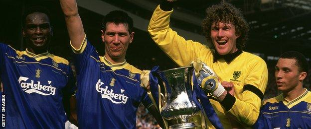 Lawrie Sanchez (second left) celebrates with Eric Young (left) and keeper Dave Beasant after Wimbledon beat Liverpool to win the FA Cup in 1988