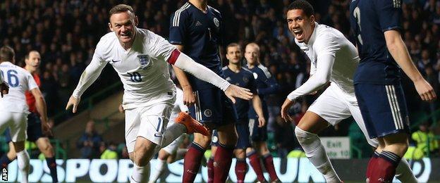 Wayne Rooney celebrates putting England 2-0 ahead at Celtic Park