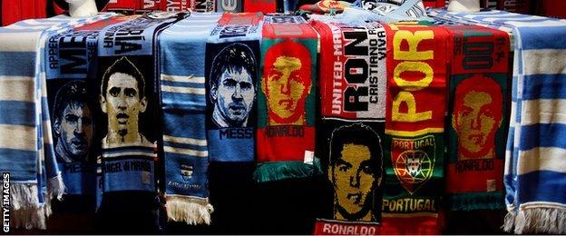 Lionel Messi and Cristiano Ronaldo scarves on sale at Old Trafford