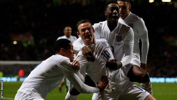 Wayne Rooney celebrates his second goal in England's 3-1 win at Celtic Park