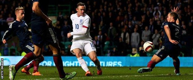 Wayne Rooney scores England's third