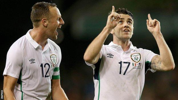 Robbie Brady [right] after scoring his late free-kick against the USA as team-mate David Meyler also celebrates