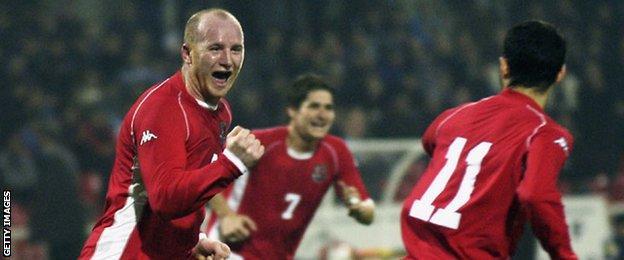Hartson celebrates scoring for Wales
