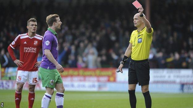 Bristol City's Wade Elliott is shown a straight red card by referee Darren Drysdale after clashing with Swindon's Jack Stephens