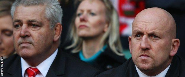 Warren Gatland (left) and Shaun Edwards watch England lose to Wales at Twickenham in 2012
