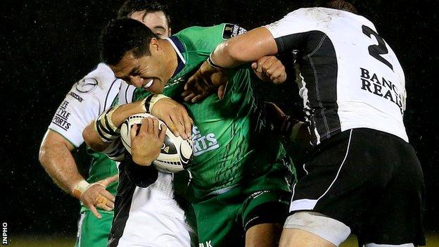 Connacht's Mils Muliaina is tackled by Zebre pair Andries van Schalkwyk and Oliviero Fabiani