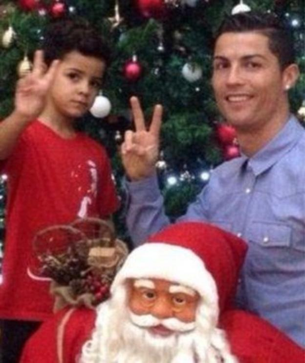 Cristiano Ronaldo poses with his son