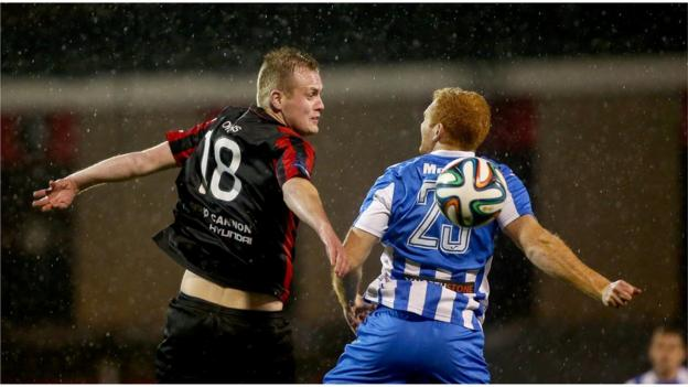 Crusaders striker Jordan Owens and Coleraine's Joe McNeill in action as Stephen Baxter's side run out 3-0 winners at Seaview