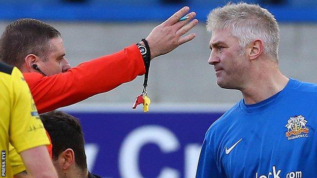Referee Robert Crangle sends off Glenavon defender William Murphy