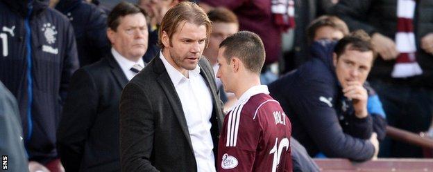 Hearts head coach Robbie Neilson and midfielder Jason Holt