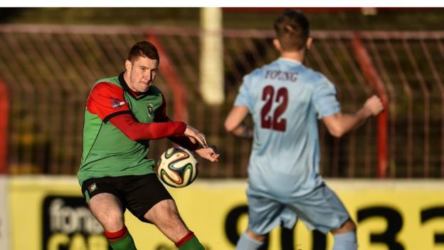 Kym Nelson and Matty Young in action during Glentoran's match against Institute at the Oval