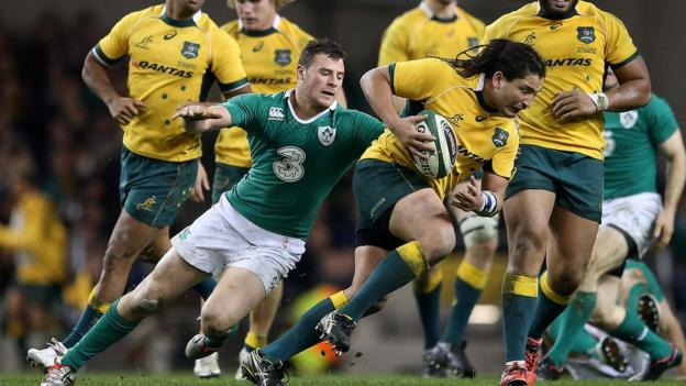 Robbie Henshaw gets to grips with Saia Fainga'a during Ireland's final autumn international against Australia