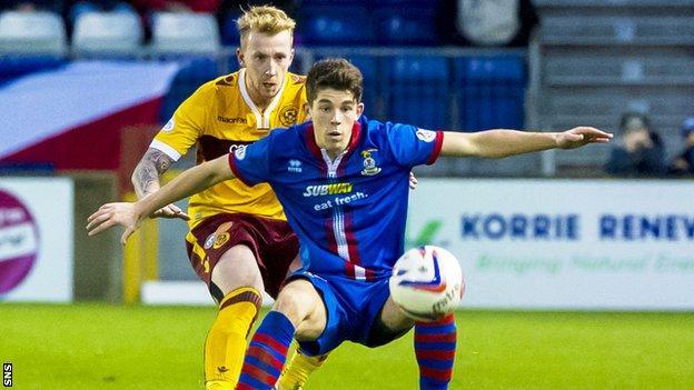 Inverness' Ryan Christie put under pressure from Motherwell's Craig Reid (left).