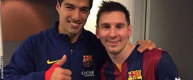 Luis Suarez with Lionel Messi