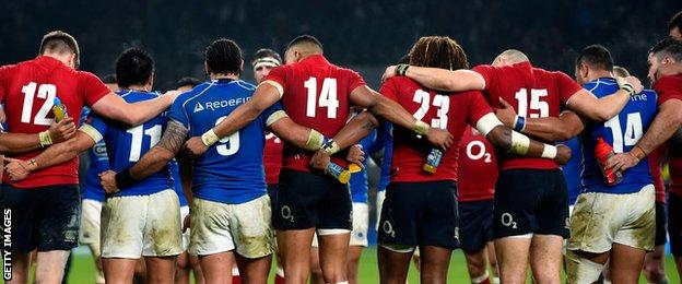 England and Samoa link arms after the final whistle