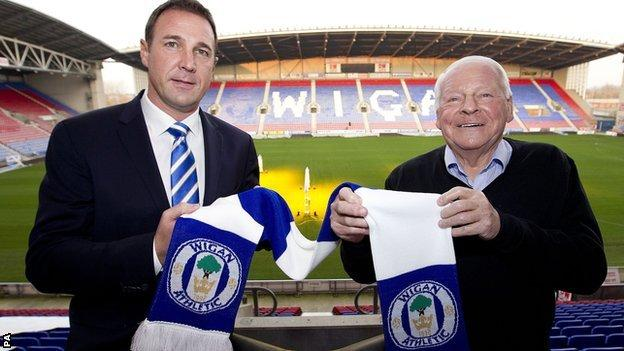 Malky Mackay and Dave Whelan (right)