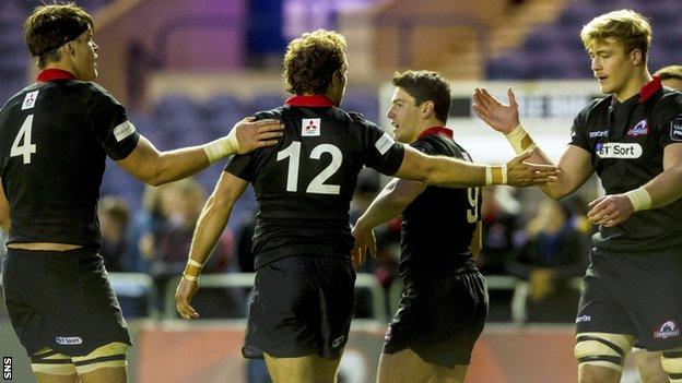 Andries Strauss (centre) celebrates scoring a try for Edinburgh
