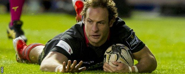 Edinburgh's Andries Strauss touches down for the first try of the match