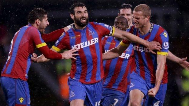 Mile Jedinak (centre) celebrates