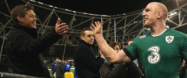 Former Ireland fly-half Ronan O'Gara congratulates captain Paul O'Connell on beating Australia