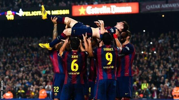 Players carry Lionel Messi on their shoulders