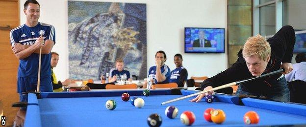 Neil Robertson clears up against John Terry during a visit to Stamford Bridge last year