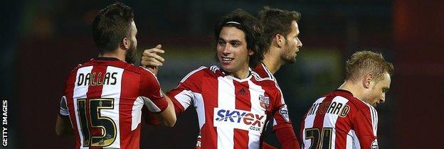 Brentford midfielder Jota (centre) celebrates his winning goal against Fulham on Friday night