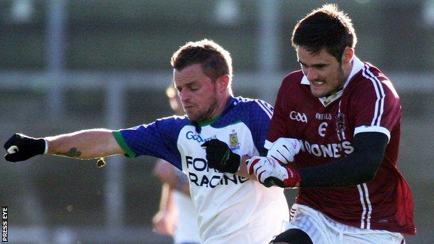 Ballinderry's Raymond Wilkinson and Slaughtneil's Chrissy McKaigue