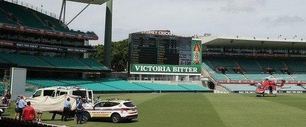 Ambulance on the pitch at Sydney cricket ground (25 Nov 2014)
