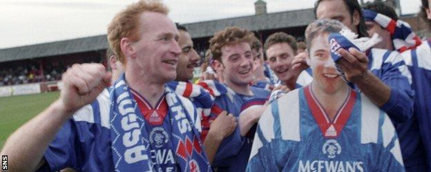 John Brown celebrates with a cardboard cut-out of Ally McCoist